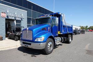 front left view of exterior 2021 blue kenworth t370 dump truck