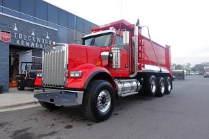 front left view of exterior 2021 viper red kenworth w900b dump truck