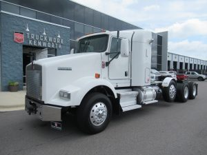 front left view of exterior 2017 white kenworth t800 sleeper lowboy