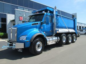 front left view of exterior 2021 blue kenworth dump truck