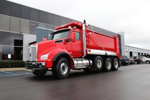 front left view of exterior 2021 red kenworth dump truck